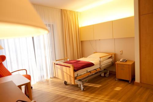 Gästezimmer mir Patientenbett